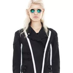 NWT Acne Studios Moi Scuba Leather Biker Jacket 36 New with tags authentic Acne Studios biker jacket. Leather with a scuba look and feel! Awesome details including contrast stripe, heavy duty zippers and quilted shoulders/elbows. Originally retailed for 2400 plus tax! Sold out at all major retailers. Size 36 which is about a US size 6 so would best fit a S/M Acne Jackets & Coats