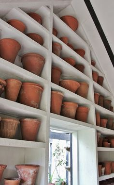I would be in HEAVEN if I had this potting shed. I love a variety of pot sizes and shapes.