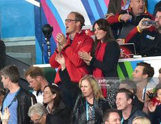 At the England vs.Wales match at Twickenham, wearing black/ecru floral print trousers by Zara, red Hugo Boss scarf & black jacket with large buttons and velvet/faux fur trim - September 26th, 2015.-