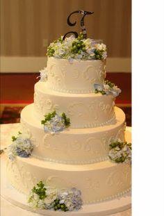 White on White Wedding Cake with fresh flowers