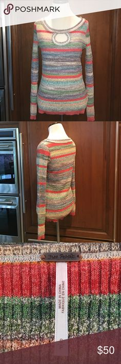 """Free People """"Sunshine Dreamer"""" Sweater Multicolored striped ribbed snug fitting sweater in muted rainbow hues.  Beautiful on and recently seen in the season finale of """"The Middle""""!  Never worn (no tags) and in perfect condition.  Acrylic/cotton/nylon/poly blend. Hand wash or dry clean. ❤️  NO TRADES NO PYPL WILL NOT DISCUSS PRICE IN COMMENTS Free People Sweaters Crew & Scoop Necks"""