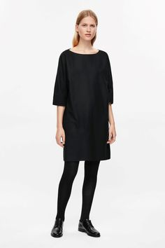 A loosely fitted, oversized style, this dress is made from a smooth wool with a slight stretch. Designed with 3/4 kimono sleeves, it has a wide neckline, subtle in-seam pockets and a simple, straight hemline.