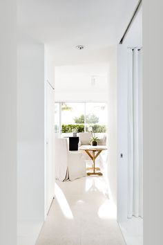 Begian Linen and Limestone flooring soften this otherwise minimal design by Michael Dawkins