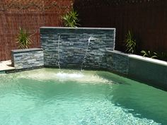 Water Features: Swimming Pool Waterfalls And Fountains | InteriorHolic.com
