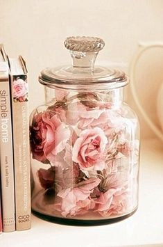 Dried roses in a jar. I do this. I have one rose dried and saved for every bouquet Tim has brought me in a huge glass orb shaped vase. There's a good 20 in there of all colors. If I could figure out how to dry other flowers from other bouquets it would have overflowed by now. ❤