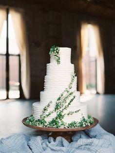 Stunning ruffled buttercream frosting with greenery wedding cake. www.highfieldhallweddings.com