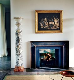 A painting by William Tomkins above the glass-backed fireplace.