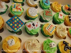 Cupcakes: Retro board games themed mini cupcakes. Handmade sugarpaste decorations; jenga, connect four, scrabble, battleship, chess, trivial pursuit, monopoly, dice, noughts crosses, playing cards snakes and ladders. www.facebook.com/thegrovecupcakery