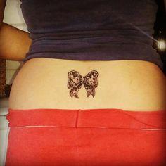Cute bow back tattoo