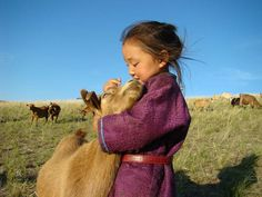 Asian girl w/ goats