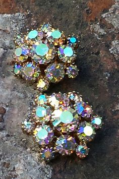 WEISS Earrings Aurora Borealis~Vtg Clip-On earrings~Signed Weiss Sparkly Rhinestones~Holiday earrings~Quality Estate Jewelry~Bridal Jewelry. by JewelsandMetals on Etsy https://www.etsy.com/listing/255156271/weiss-earrings-aurora-borealisvtg-clip