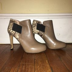 BRAND NEW VINCE CAMUTO HEELS BRAND NEW, NEVER WORN!! Leather Vince CAMUTO bootie with skin detailing. Cinches around ankle. Beauty Taupe color! Perfect for the winter with a black skinny jean!! Vince Camuto Shoes Ankle Boots & Booties