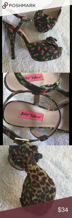 """Betsey Johnson platform floral pumps sandals 8.5 These are sooo cute! Floral fabric has pink roses flowers, and the background is almost black. Ankle straps with buckle. The sole is a fabric leopard print with non-slip texture, features the classic gold brass Betsey Johnson heart. Peep toe ❤️ Knotted bow on the toe area. Size 8.5, style name Haylie. ▪️ stiletto, spiked, pin-up, sexy, wedding, party, dancing ▪️ Approx measurements are.....  ▪️Heel height is 5.75"""" ▪️Platform height is 1.25""""…"""