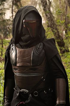A little to sci fi in feel perhaps but I like the idea of covering face with a combo of cowl. hood and mask.