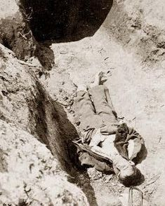 Confederate boy, age 14, lies dead in trenches of Fort Mahone, 1865
