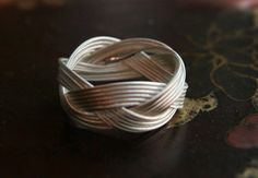 sterling silver braided ring monkey fist knot by theili on Etsy, i want this.