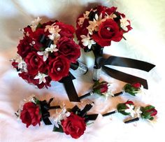Red rose bridal bouquet in red white black wedding bouquet and boutonniere package. $136.00, via Etsy.