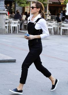"In style ""Emma Watson looking fab in dungarees, over a crisp white shirt, and leather slip-ons."""