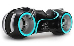 We knew there was a Tron Lightcycle that was street legal, and there was even one for sale from Hammacher Schlemmer, but this one's different: it's created by the motorcycle designers at Parker Brothers Choppers.