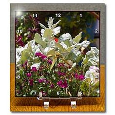 Flowers and pretty leaves in a garden in the spring Desk Clock