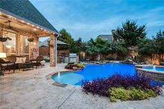 Outdoor living with kitchen, pool & hot tub.  Find North Texas luxury homes at www.BirdsongRealty.com
