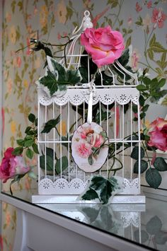 Birdcage dressed with lace, pink roses and ivy.