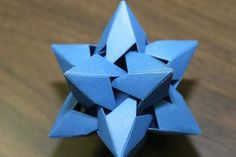 three-dimensional origami star by Miyuki Kawamura  the name of this site makes me want to check out the whole site.