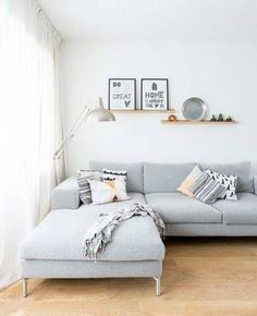 Pale greys and silver metal accent make for a chic, fresh space.