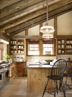 Rustic Kitchen with pendant lights and limestone tile floors.  #kitchens #rustickitchens homechanneltv.com