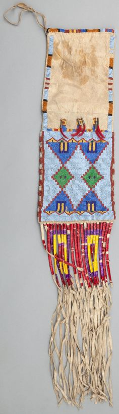 A SIOUX BEADED HIDE TOBACCO BAG. c. 1900... Image #1