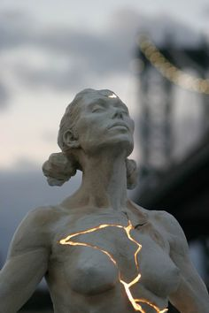 The Kintsugi Effect: Lit From Within! Paige Bradley broke a wax sculpture she spent 6 months making - cast the broken pieces in bronze, then reassembled them with a lighting engineer to produce this startling sculpture in NYC