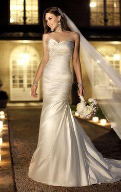 418237df516 Gorgeous designer wedding dress has figure-flattering ruching and stunning  crystal details. Exclusive designer