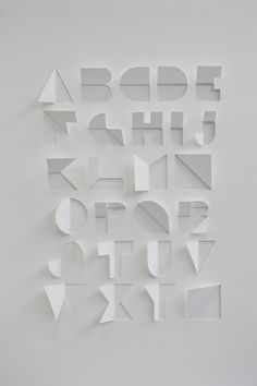 A typeface created from a single sheet of paper, with only cuts and folds. The process used to create the alphabet involved looking at origami and symmetry within letterforms. Typography Letters, Graphic Design Typography, Hand Lettering, Cursive Calligraphy, Japanese Typography, Typography Poster, Typographie Fonts, Inspiration Typographie, Schrift Design