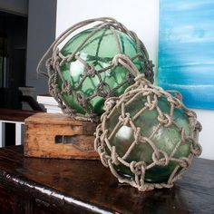 Sea glass buoy in clear or light blue/green to go on the floor by the right side of the media chest