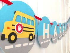 This school bus themed HAPPY BIRTHDAY banner is perfect for a little childs birthday party!   The banner is made with sixteen 6 blue circles with gray/white street design connected with red colored satin ribbon. Thirteen circles contain pearlized white HAPPY BIRTHDAY letters. Two yellow