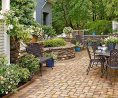 Curving stonework walls delineate this patio space to add interest and give a clean appearance.