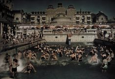 People enjoying the Gellert Bath, an outdoor swimming pool on the banks of the Danube, January 1930. Photograph by Hans Hildenbrand