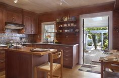 1112 Elgin Lane in Key West is a charming Key West cottage on a quiet lane in Old Town.  The attractive new kitchen features state-of-the-art appliances and opens to covered outdoor dining and lovely garden views.