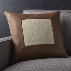 An indulgent mix of materials, the Delino pillow frames natural, textured linen in buttery soft, warm brown leather. Mitered corners add a smart, tailored look to the leather's natural grain, unique to each piece. Pillow reverses to solid linen. Our decorative pillows include your choice of a plush feather-down or lofty down-alternative insert at no extra cost.