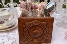 An old Singer sewing machine drawer  holds jars of vintage cutlery. From Tiers for Tea.