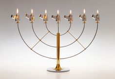 """""""«zippo gasolier» by slovenia-based designer Luka Pirnat is a novel approach on two iconic items — a set of zippo lighters and a menorah, the seven-branched candelabrum used as a traditional symbol of judaism."""""""
