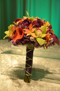 Colorful wrapped bouquet. #flowers #weddings #bride