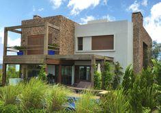 Casa Condomínio Bosques de Atlântida 1 | Bruna Charak Jany ARQUITETURA