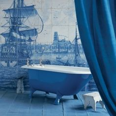 nautical tile mural and blue cast iron tub from indulgy.com