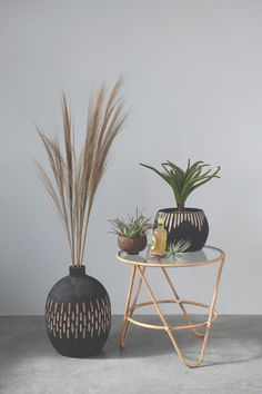 """Beautiful boho chic black paulownia wood vase with carved detail. Measurement: 10-1/2"""" Round x 15-3/4""""H Wood Vase, Wood Planters, Bamboo Table, Creative Co Op, Round Design, Black Wood, Wood Colors, Home Decor Accessories, End Tables"""
