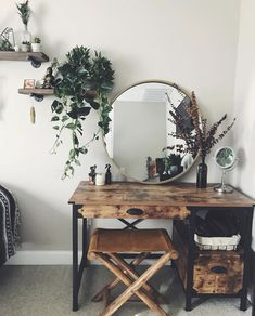 Rustic bedroom decor with brass mirror and greenery Wooden desk vanity boho makeup desk station shelf office hippie green plants eucalyptus hanging plants wood shelves industrial