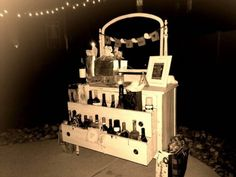 "Stock the bar idea for a wedding shower. Antique dresser refinished shabby chic with burlap sign that says ""Drink and be Married"""