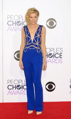Portia de Rossi in an electric-blue Zuhair Murad jumpsuit with plunging neckline at the People's Choice Awards. (Photo: Paul Buck/European Pressphoto Agency)  - NYTimes.com