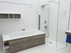 Shower and bathtub make perfect use of the corner space