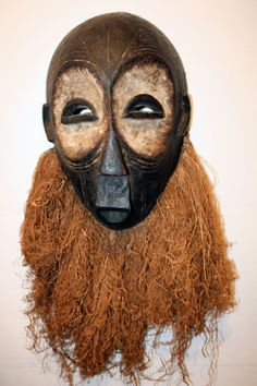 Bearded Lulua Mask (Democratic Republic of Congo)  A multi-ethnic tribe, the Lulua live on the banks of the Lulua River and are devoted to the hunt. The mask features scarification, half-moon eyes, kaolin circling the eyes and protruding lips. A full beard gives this mask an air of festivity.